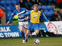 Photo: Steve Bond/Sportsbeat Images.<br /> Macclesfield Town v Hereford United. Coca Cola League 2. 26/12/2007. Trent McClenahan (R) has his ankle clipped by Kevin Mcintyre (L)