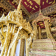 The ornate interior of Haw Pha Bang (or Palace Chapel) at the Royal Palace Museum in Luang Prabang, Laos. The chapel sits at the northeastern corner of the grounds. Construction started in 1963.