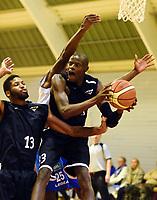 Basketball<br /> BLNO<br /> Gamle Rykkinhallen<br /> Tromsø Storm v Nidaros Jets<br /> 11.10.2014<br /> Foto: Morten Olsen, Digitalsport<br /> <br /> Brandon Moore (13) - Nidaros<br /> Earl Simba (33) - Nidaros