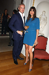 Model LISA BARBUSCIA and her husband ANTON BILTON at the Bruce Oldfield Crimestoppers Party held at Spencer House, 27 St.James's Place, London SW1 on 22nd September 2005.<br />