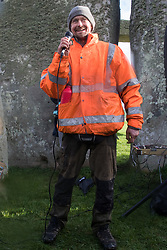 Salisbury, UK. 5th December, 2020. Dan Hooper, better known as roads protester Swampy in the 1990s, addresses over one hundred people including local residents, climate and land justice activists and pagans during a Mass Trespass at Stonehenge. The trespass was organised in protest against the approval by Transport Secretary Grant Shapps of a £1.7bn project for a two-mile tunnel beneath the World Heritage Site and a further eight miles of dual carriageway for the A303, as well as the government's £27bn Road Investment Strategy 2 (RIS2).