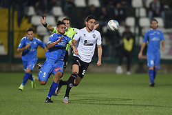 November 3, 2018 - Vercelli, Italy - Italian midfielder Nicolas Schiavi from Novara Calcio team playing during Saturday evening's match against Pro Vercelli team valid for the 10th day of the Italian Lega Pro championship and Italian defender Filippo Berra from Pro Vercelli team playing during Saturday evening's match against Novara Calcio valid for the 10th day of the Italian Lega Pro championship  (Credit Image: © Andrea Diodato/NurPhoto via ZUMA Press)