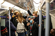 Commuters on a tube in central London on Saturday, Oct 10, 2020, after Prime Minister Boris Johnson, announced a range of new restrictions to combat the rise in coronavirus cases in England. (VXP Photo/ Vudi Xhymshiti)