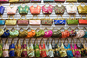 Handbags for sale at market stall in Moslem district of Xian, China