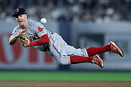 NEW YORK, NEW YORK - OCTOBER 08:   Brock Holt #12 of the Boston Red Sox fields a hit by Luke Voit #45 of the New York Yankees during the fourth inning in Game Three of the American League Division Series at Yankee Stadium on October 08, 2018 in the Bronx borough of New York City. (Photo by Elsa/Getty Images)
