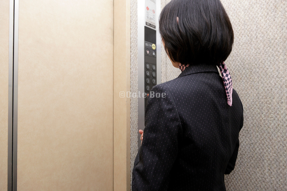 woman in elevator Tokyo Japan