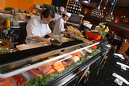 Chefs prepare different plates of Sushi at a Japanese Sushi restaurant in Orlando, Florida.
