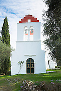 Whitewashed Greek Orthodox church at Nimfes, Nymfes, in Northern Corfu,  Greece
