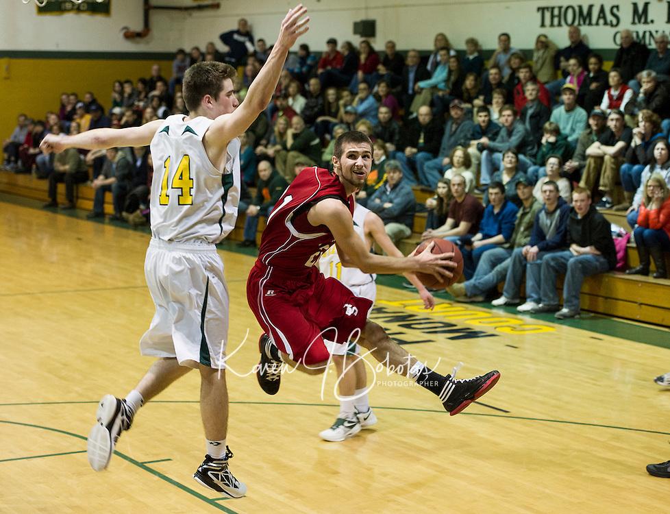 John Stark's Adam Wasiewski jumps for the basket past Bishop Brady's Stephen Desmarais during NHIAA first round Division II basketball Wednesday evening.  (Karen Bobotas/for the Concord Monitor)