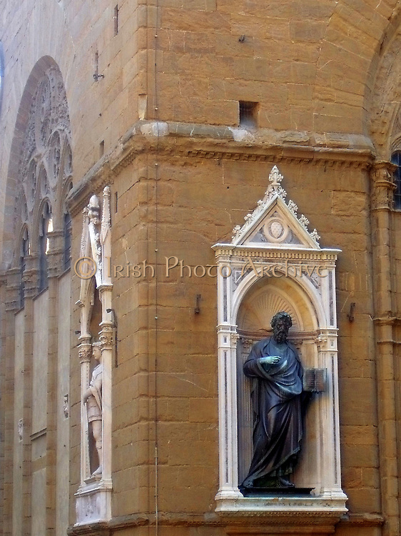 Statue detail on out outside of a church in Florence, Italy. Semi enclosed figurative statues such as this appear all over Florence. This is a statue of St. Peter.
