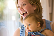 A mother holds her nine-month old baby boy