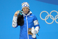 February 15, 2018 - Pyeongchang, South Korea - KRISTA PARMAKOSKI of Finland celebrates receiving the bronze medal for the Ladies' 10km Free cross-country event In the PyeongChang Olympic games. (Credit Image: © Christopher Levy via ZUMA Wire)