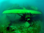 The Aircraft Cessna wreck covered with green algae at Dutch Springs in Bethlehem, Pennsylvania
