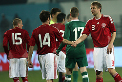 The End of UEFA Friendly match between national teams of Slovenia and Denmark at the Stadium on February 6, 2008 in Nova Gorica, Slovenia. Slovenia lost 2:1. Thomas Rasmussen gives his hand to Ulrik Laursen of Denmark. (Photo by Vid Ponikvar / Sportal Images).