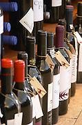 Wine shop. Wine bottles with tied neck labels. Lisbon, Portugal