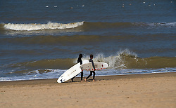 Searching for waves to surf in De Haan, Belgium, Sunday, Sept. 14, 2008. (Photo © Jock Fistick)