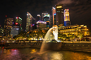 The Merlion Fountain and downtown skyline at night, Singapore, Republic of Singapore