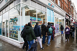 © Licensed to London News Pictures. 14/03/2020. London, UK. Shoppers queue outside Savers, north London. 798 cases have been tested positive and 11 patients have died from the virus in the UK. Photo credit: Dinendra Haria/LNP