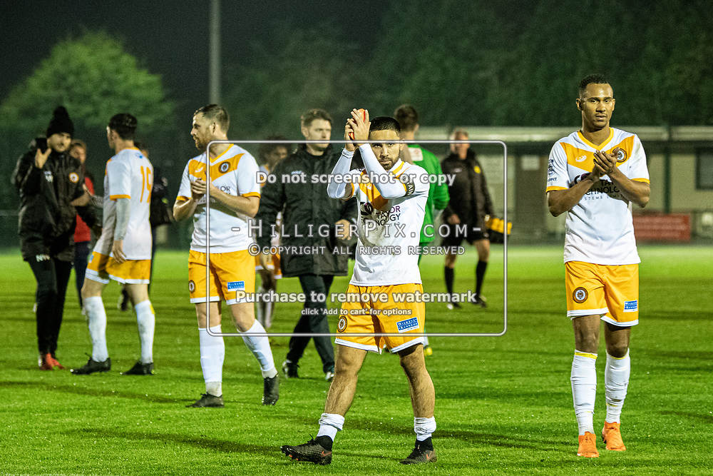 MERSTHAM, UK - OCTOBER 15: Barney Williams, of Cray Wanderers FC, & Mitchell Nelson, of Cray Wanderers FC, applaud the Cray Wanderers fans after the BetVictor Isthmian Premier League match between Merstham and Cray Wanderers at The Whisky Bible Stadium on October 15, 2019 in Merstham, UK. <br /> (Photo: Jon Hilliger)