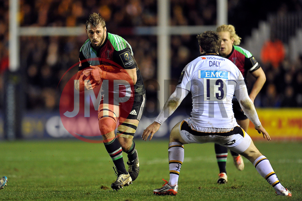 Chris Robshaw of Harlequins takes on the Wasps defence - Photo mandatory by-line: Patrick Khachfe/JMP - Mobile: 07966 386802 17/01/2015 - SPORT - RUGBY UNION - London - The Twickenham Stoop - Harlequins v Wasps - European Rugby Champions Cup
