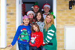 The whole 'family' pose at the front door of Barby and Mike's Portslade home. Brighton, December 16 2018.
