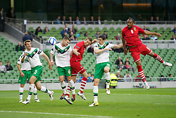 DUBLIN, REPUBLIC OF IRELAND - Friday, May 27, 2011: Wales' Daniel Gabbidon and Danny Collins in action against Northern Ireland's Oliver Norwood and Craig Cathcart during the Carling Nations Cup match at the Aviva Stadium (Lansdowne Road). (Photo by David Rawcliffe/Propaganda)