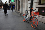 A Mobike dockless sharing bicycle left on the street in London, United Kingdom. The increasing use of dockless sharing bikes in London comes after two Chinese companies, Ofo and Mobike, launched their mobile app-based service in the capital.
