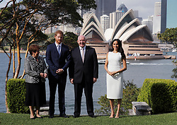 The Duke and Duchess of Sussex, Australia's Governor General Peter Cosgrove and his wife Lynne Cosgrove stand in the grounds of Admiralty House in Sydney, with a view of the Sydney Opera House, on the first day of the royal couple's visit to Australia.