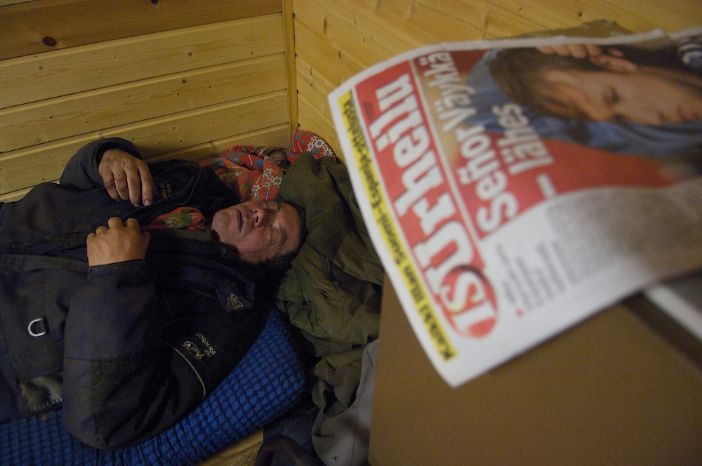 Hirvas Salmi, FINLAND. October 18, 2007- Collapsed from the exhaustion of working three consecutive 14 hour days, Veggai, 58, slumbers in his friends cabin.