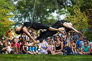 Aerial silk artists from the Clean Lakes Circus perform during the Makeshift Festival at Tenney Park in Madison, Wisconsin, Sunday, Aug. 12, 2018.