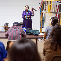081613       Cable Hoover<br /> <br /> Lois Becenti tells a crowd about the traditional significance of a woven sash during a weaving demonstration at Octavia Fellin Public Library in Gallup Friday.