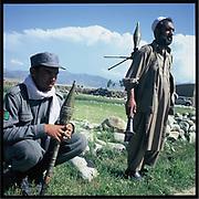 Afghan police observe the drug eradication efforts in a poppy field in Jalalabad.