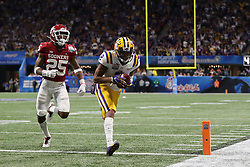 Justin Jefferson #2 of the LSU Tigers scores a touchdown during the first half against the Oklahoma Sooners in the 2019 College Football Playoff Semifinal at the Chick-fil-A Peach Bowl on Saturday, Dec. 28, in Atlanta. (Jason Parkhurst via Abell Images for the Chick-fil-A Peach Bowl)