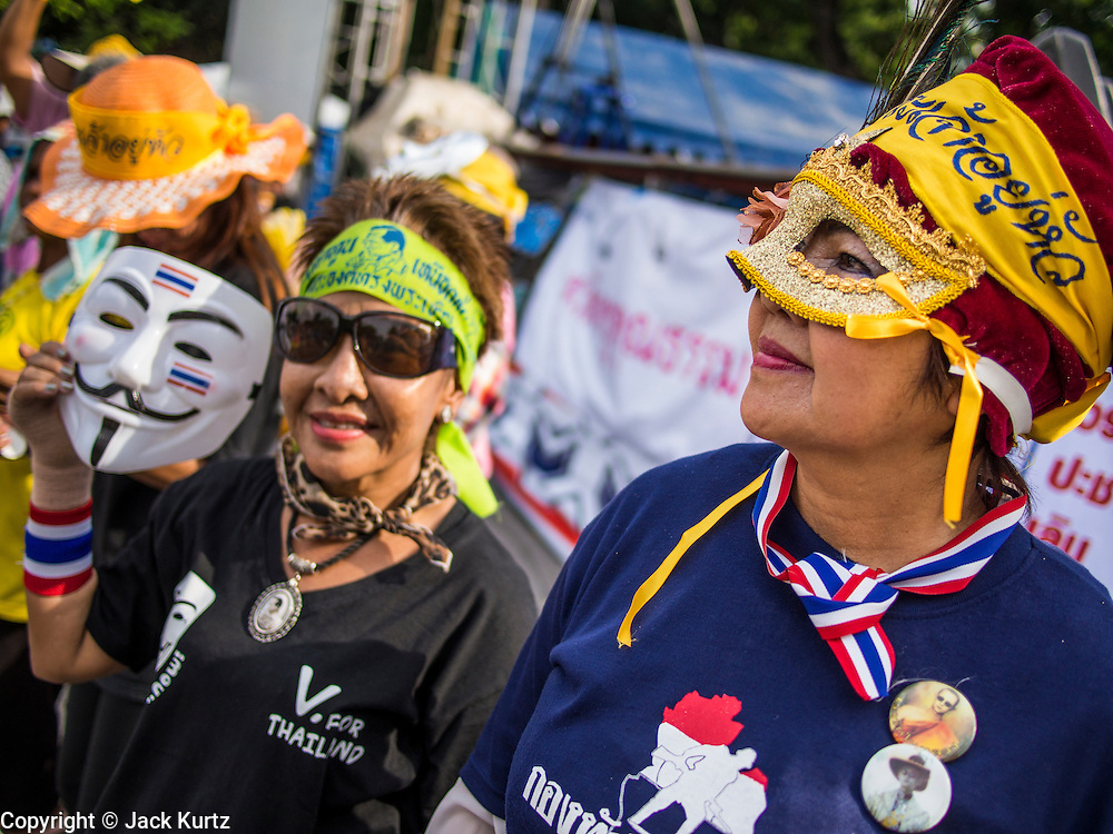 05 AUGUST 2013 - BANGKOK, THAILAND:  Anti-government protestors during an anti-government protest in Bangkok. About 500 people, members of the  People's Army against Thaksin Regime, a new anti-government group, protested in Lumpini Park in central Bangkok. The protest was peaceful but more militant protests are expected later in the week when the Parliament is expected to debate an amnesty bill which could allow Thaksin Shinawatra, the exiled former Prime Minister, to return to Thailand.    PHOTO BY JACK KURTZ
