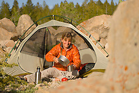 A young woman camps in the Gros Ventre Mountains near Jackson Hole, Wyoming.