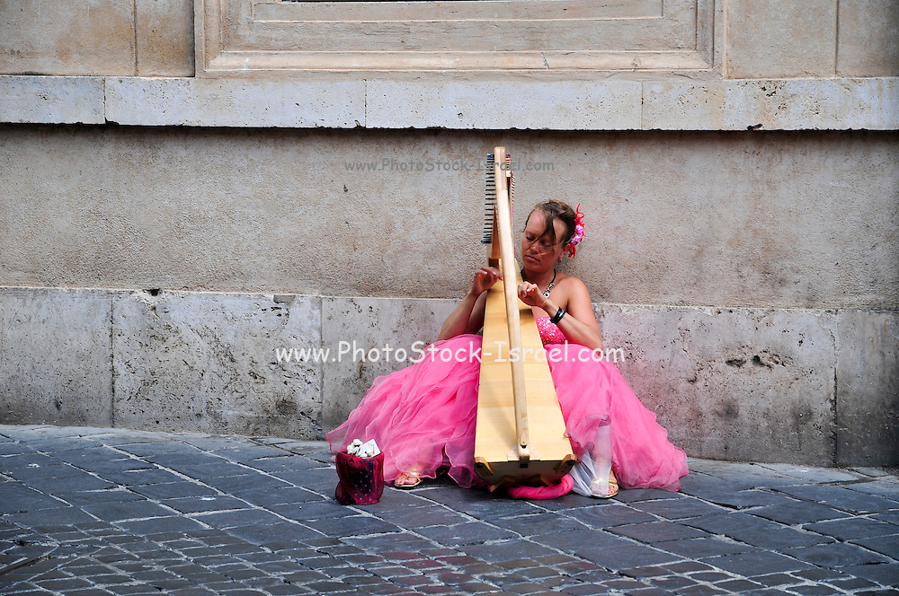 Rome, Italy Street performer Harpist in pink