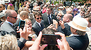 © Licensed to London News Pictures. 31/07/2014. Chichester, UK Hollywood actor Tom Cruise makes his way through crowds of racegoers.  Ladies Day at Glorious Goodwood at Goodwood racecourse in Chichester today 31/07/14. Photo credit : Stephen Simpson/LNP