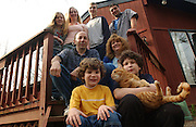 Adam, age7, front left, and Jeffrey, age 9, holding their cat are seen with their parents and 4 other siblings at their home in Toms River, NJ.     <br /> Adam Jones, age 7, and Jeffrey Jones, age 9, are two brothers out of 6 siblings that have different forms of autism . Their family integrates them into all forms of daily life, which include little league, physical therapy, private tutoring sessions and family meals. Every year it costs around $50,000 per child to get them the help they need to become more socialized.