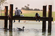 On a mild summer day with the temperatures in the mid-80s, Fair Oaks resident Bill Blaylock and his son Frank Blaylock, 11, try their luck fishing at Gibson Lake on Gibson Ranch in Elverta.
