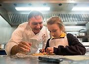 © Licensed to London News Pictures. 03/11/2014. Oxford, UK. RAYMOND BLANC cooks ravioli with local school girl Baileigh Higgs aged 8.  To celebrate National School Meals Week (3-7 November), the Deputy Prime Minister, Nick Clegg, joins school children at Brasserie Blanc in Oxford to get some top cooking tips from Raymond Blanc. The visit is part of a larger national effort to raise awareness of and enhance children's relationship with food. The Deputy Prime Minister has called on celebrity chefs to lead the way by joining forces with school cooks to promote the great school lunch. School cooks up and down the country will be taking their skills out of the school kitchen to showcase to parents and pupils the variety and quality of food now being served in schools. National School Meals Week comes just months after the launch of free school meals for 2.8 million primary school children and the introduction of cooking in the curriculum.. Photo credit : Stephen Simpson/LNP