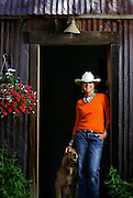 SHOT 7/17/2006 - Elizabeth LeCoq Currier bought a lot with two rusted and dilapidated sheds along Coal Creek in Crested Butte for $140,000 in 1997, the highest price paid at that time. Because of historic regulations the sheds couldn't be torn down so she turned one into a master suite and the other into a bunkhouse and also added a two-story living space adjacent to the sheds that matched the look of the sheds pretty closely. The home has been featured in numerous magazines and is important because the project preserved the flavor of Crested Butte's  mining history. The project took a number of years to complete and incorporates 100 year old ceiling beams and 300 year old wood floors. LeCoq Currier poses for a portrait with Barley, one of her Golden Retrievers, in the doorway to the boys bunkhouse..(MARC PISCOTTY/ © 2006)