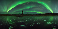 At the end of October I had the the chance to spend a week in Alaska. I timed this trip with the arrival of a solar wind stream so the northern lights would be extra active. The sky only stayed clear for a couple hours on this night, but that was enough to see this bright 'aurora rainbow.' Only by shooting a panorama with my widest lens could I capture all of it. Most of the lakes and wetlands around Fairbanks had these bubbles in them. They are made of methane gas suspended in the ice. Just 30-40 cm underground is the permafrost, which normally stays frozen year round. But as the Arctic warms and the permafrost thaws, the decaying plant matter (also known as peat) releases methane into the atmosphere. During the summer this gas is invisible. But for a short time after the water freezes and before it gets covered with snow, these frozen bubbles are visible. Many area lakes have such a high concentration of methane that it's actually possible to pop these bubbles and light them on fire.