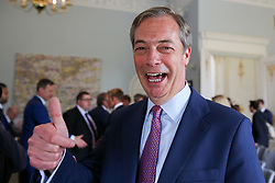 © Licensed to London News Pictures. 07/05/2019. London, UK. Nigel Farage, Leader of Brexit Party gives a thumbs up as he leave the press conference. Photo credit: Dinendra Haria/LNP