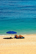 Couple sunbathing on the famous Turquoise waters of Myrtos Beach (??????? ??????), Kefalonia, Greek Ionian Islands .<br /> <br /> Visit our GREEK HISTORIC PLACES PHOTO COLLECTIONS for more photos to download or buy as wall art prints https://funkystock.photoshelter.com/gallery-collection/Pictures-Images-of-Greece-Photos-of-Greek-Historic-Landmark-Sites/C0000w6e8OkknEb8
