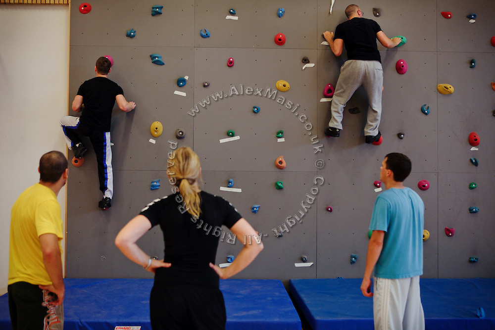 Inmates are taking part to a climbing session during the time they regularly spend carrying out physical exercise and learning about the human body inside the luxurious Halden Fengsel, (prison) near Oslo, Norway.