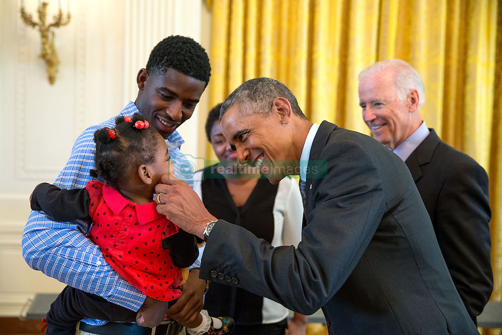 President Barack Obama greets a little girl as he and Vice President Joe Biden meet with wounded warriors and their families in the East Room during a tour of the White House, Sept. 22, 2014. (Official White House Photo by Pete Souza)<br /> <br /> This official White House photograph is being made available only for publication by news organizations and/or for personal use printing by the subject(s) of the photograph. The photograph may not be manipulated in any way and may not be used in commercial or political materials, advertisements, emails, products, promotions that in any way suggests approval or endorsement of the President, the First Family, or the White House.