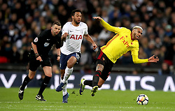 Tottenham Hotspur's Mousa Dembele (centre) and Watford's Etienne Capoue battle for the ball