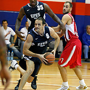 Efes Pilsen's Igor RAKOCEVIC (F) and Erwin DUDLEY (C) during their friendly basketball match Efes Pilsen between Olympiacos at Efes Pilsen Arena in Istanbul, Turkey, Sunday, October 03, 2010. Photo by TURKPIX