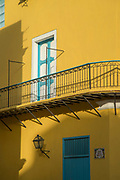 Part of city building with balcony and doors, Calle de la Obra-Pia, Havana, Cuba