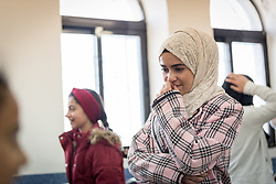16 February 2020, Irbid, Jordan: Children play a game of 'mirroring', whereby one of them leads and the other has to mimmick what she is doing. This, during a psychosocial support session for Syrian refugee children and Jordanian host communities, led by the Lutheran World Federation at the Islamic Centre in Al-Mazar.